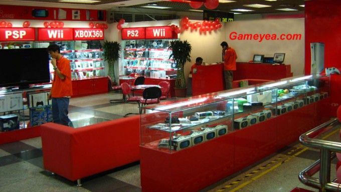 One of China's many shops that sells game consoles. Look at all those customers demanding Western game consoles. Oh wait, there aren't any customers. The guys in red work there.