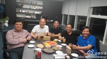 Titans of industry: Kingsoft, YY, and Xiaomi execs apparently celebrating the finalized deal.
