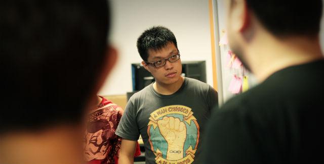Gameplay programmer Benjamin Chua in a work meeting - or scrum.