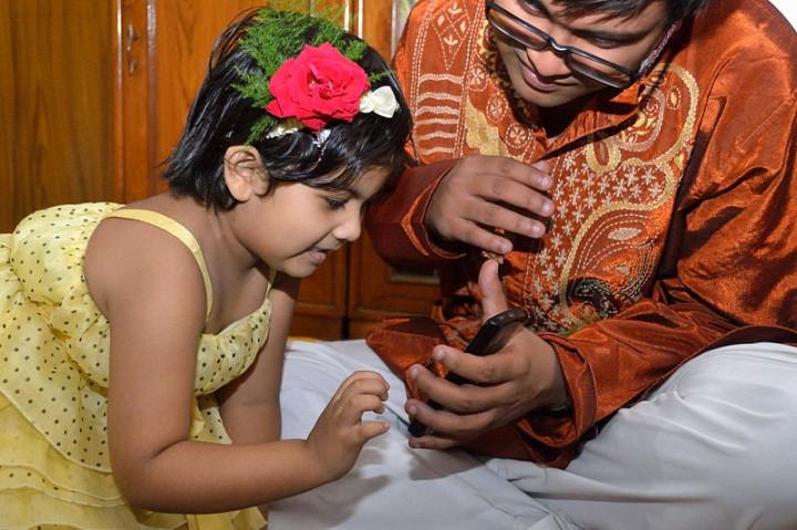 india kid touching smartphone