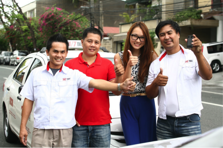 Bautista with some GrabTaxi drivers. (L-R): Mark Villarin, Oliver Bocuya, Natasha Bautista, Rene Regalado.