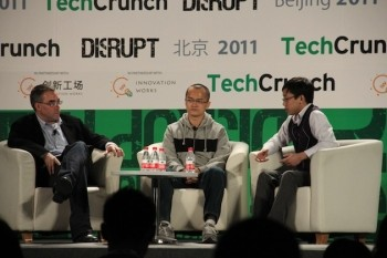 Du Yinan (right) discussing 24quan's impending profitability at Techcrunch Disrupt. A month later his company suffered sudden, widespread layoffs.