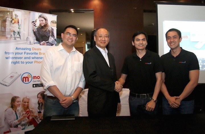 IdeaSpace President Earl Martin Valencia, Globaltronics CEO William Guido, and Mobkard co-founders Francis Uy and Carlo Calimon