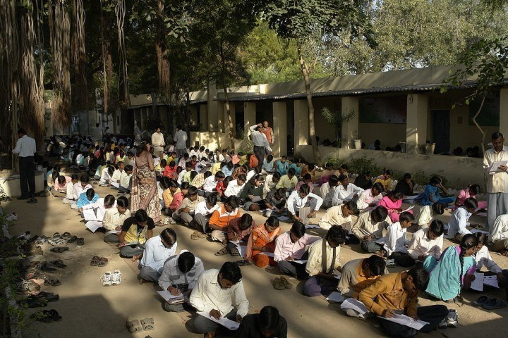 Photo credit: Wikipedia Students taking exams in Jaura, India