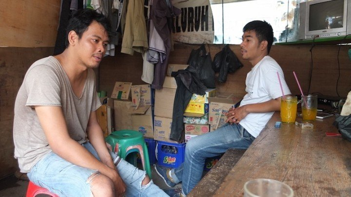 Drivers Hidayat (L) and Sadarno (R) have been with Go-Jek for four months.