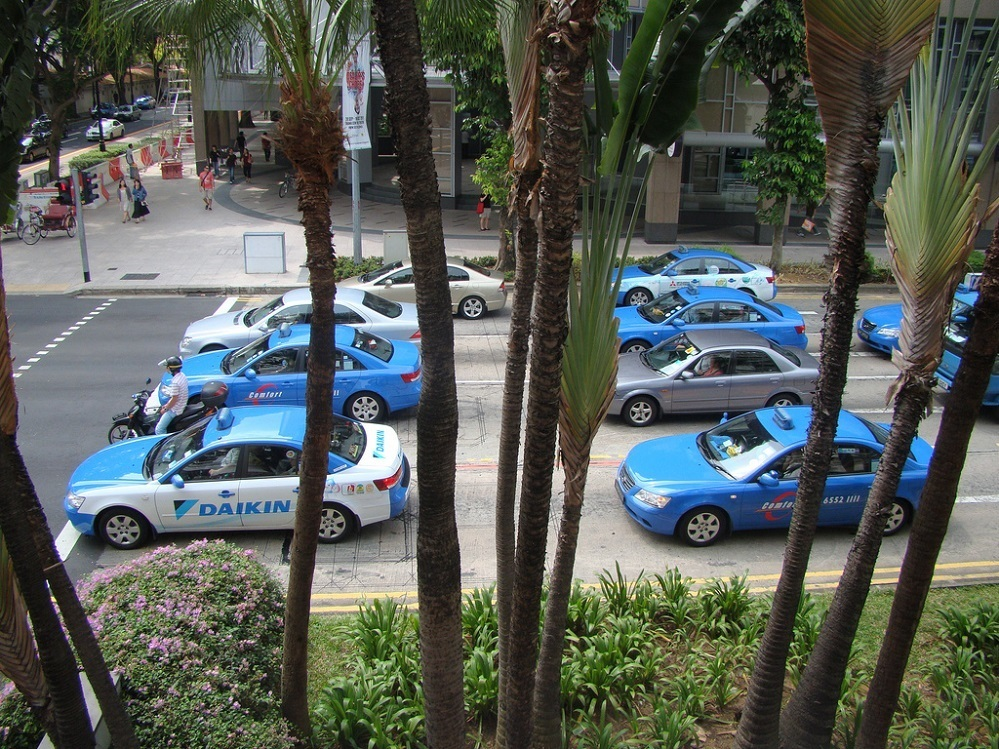 Taxis waiting at traffic light in Singapore