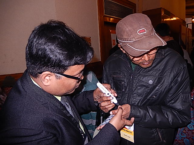 A BarrierBreak employee demonstrates Touch Memo, a voice-activated label maker, to a visually impaired individual