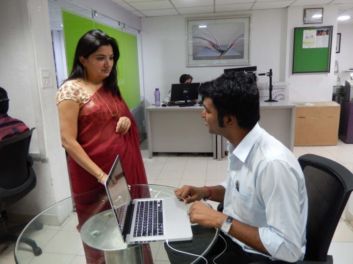 Shilpi Kapoor, founder and managing director of BarrierBreak, aids a visually impaired computer user.